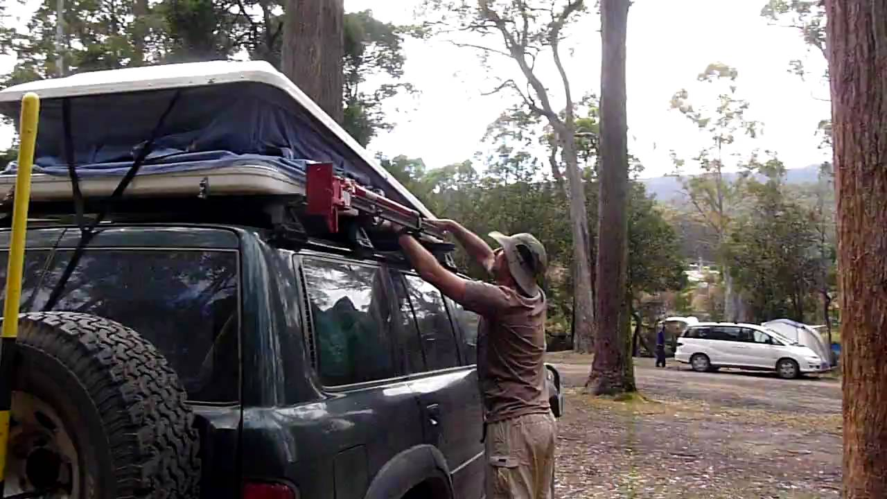 & Packing up the roof top tent in 1 minute - YouTube