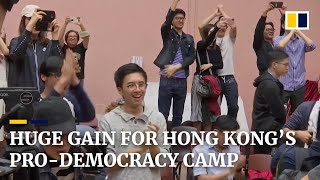 Hong Kong votes overwhelmingly for pro-democracy camp with record turnout in local elections