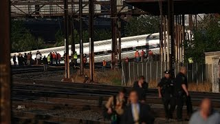 Investigators Search for Clues in Deadly Amtrak Crash