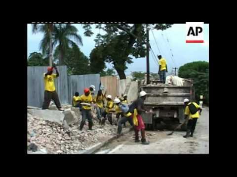 Reconstruction continues, building using quake debris