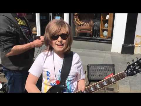 Geai Thompson, age 10, busking in Wick, Caithness, on 3 June 2017