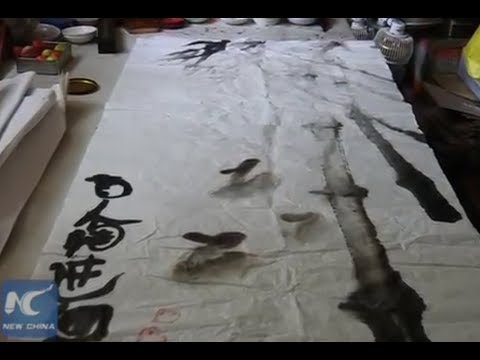 Blind man paints the world of his imagination