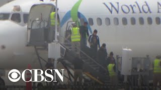 Migrants being flown to less crowded facilities by U.S. immigration officials