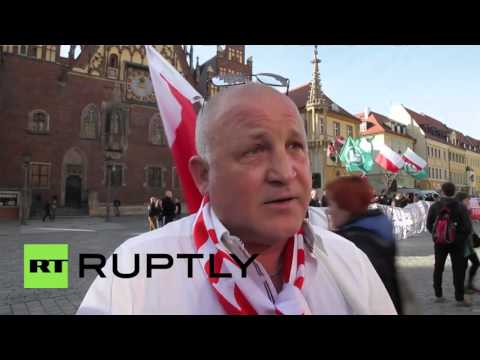 RUPTLY / Berlin - Merkel picture burns as right wingers protest (news report, Poland)