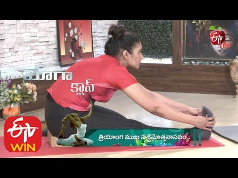 yoga class  triyanga mukha paschimottanasanam with block