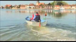 Self confessed 'nutter' invents weird amphibious craft made from a lawnmower and a sailing boat