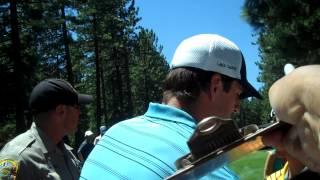 Aaron Rodgers signing autographs at 2013 American Century Lake Tahoe golf event