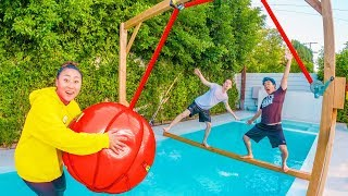 TODAY I MADE A WRECKING BALL OVER THE FREEZING COLD POOL!! WHOEVER FALLS IN LOSES AND THE LAST ONE STANDING WINS 略 GET YOUR ...