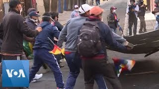 Police and Protesters Clash in Bolivian Capital