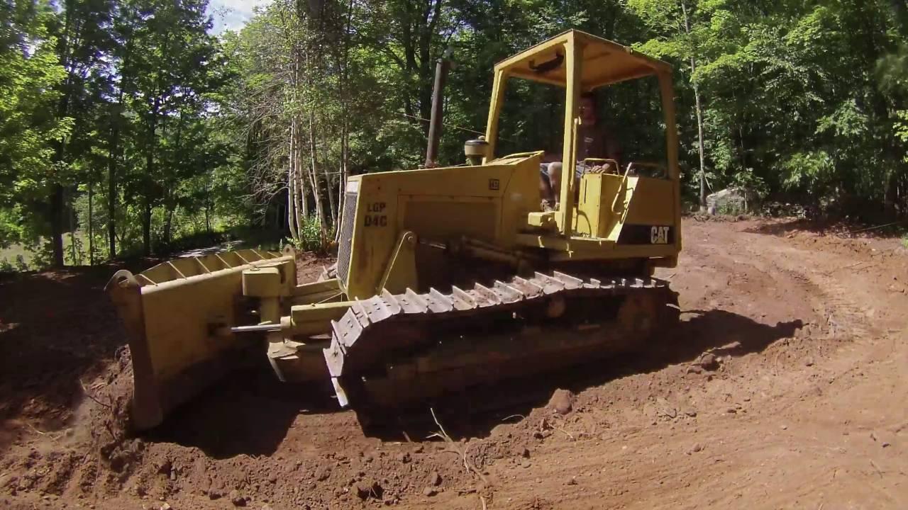 cat d4c dozer pushing dirt