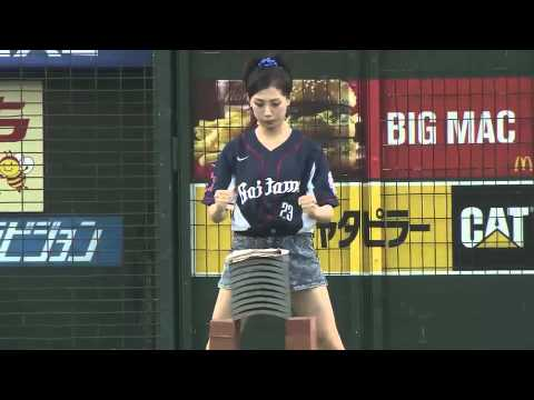 Rina Takeda smashes blocks with head, throws out first pitch