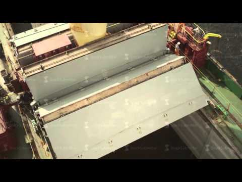 Closing the Hatch of Hold on a Cargo Ship