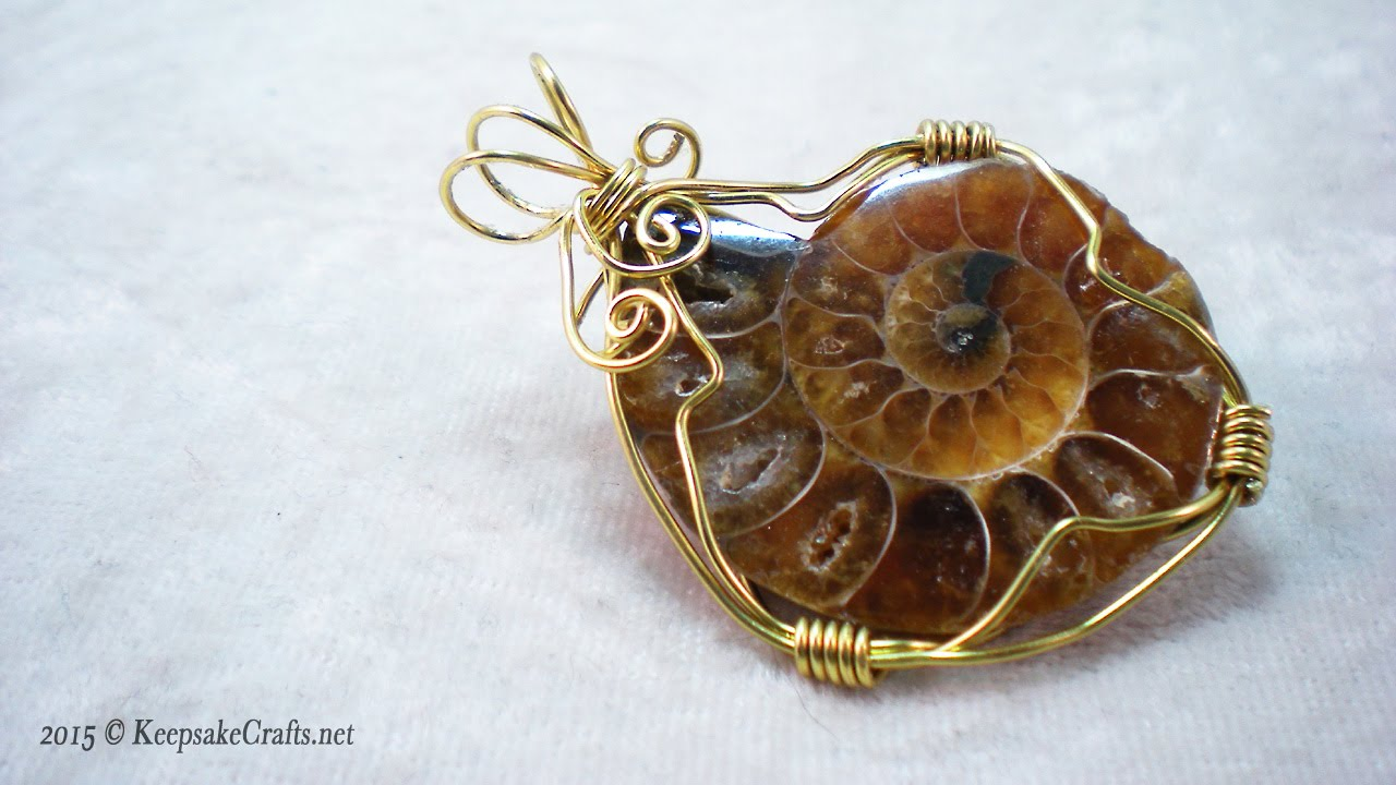 How to make wire wrapped ammonite jewelry youtube how to make wire wrapped ammonite jewelry aloadofball Images