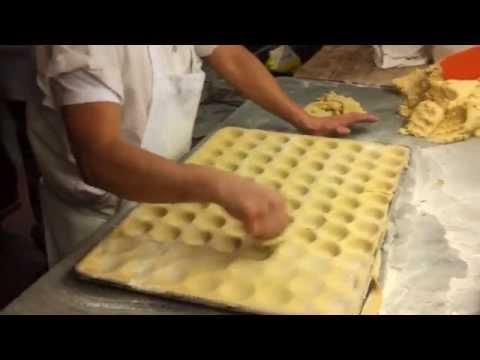 Veniero's baker making handmade tart shells.