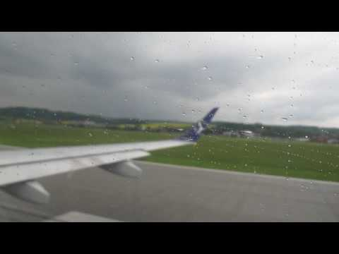 LOT Polish Airlines Embraer 195 SP-LNE Rainy take off from Krakow