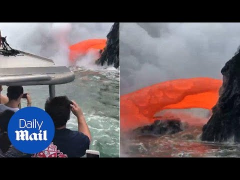 Spectacular moment volcano lava spews into sea yards from tourists - Daily Mail