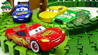 Disney McQueen car. Cross the road and the bridge. Color road toy.