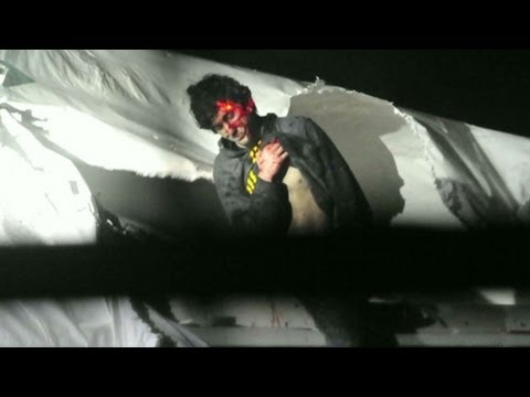 Chilling photos of Boston bombing suspect when captured