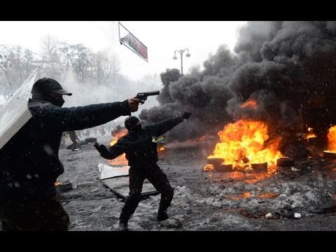Ukraine: protesters man tyre barricades as they call for 'more radical action'
