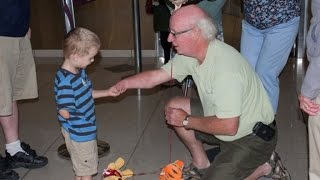 Adopted Boy with One Hand Bonds with New Grandpa Over Shared Condition