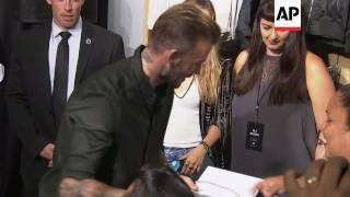 David Beckham greets fans at the launch of his latest H and M collaboration