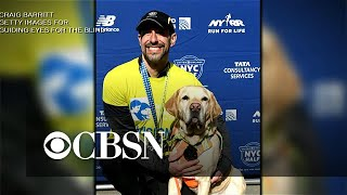 Dogs lead blind man to the finish line