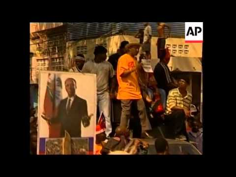 Marches For And Against President Jean-Bertrand Aristide