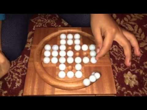 4 Year old playing Chinese Checkers game