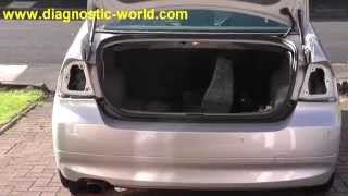BMW E90 Rear Tail Light Cluster Removal Guide