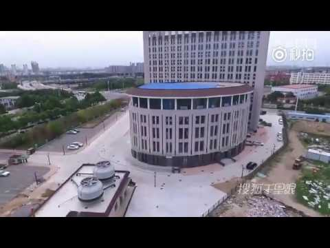 Building looks alike toilet built on campus at a university in central China's Henan