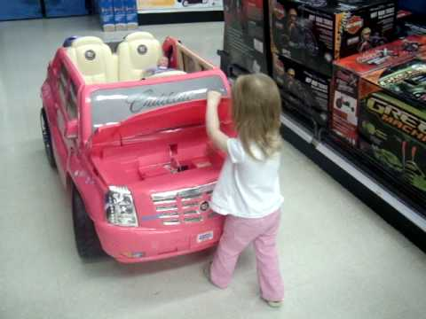 her new fave thing at toys r us the pink car that she likes to ride in