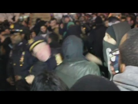 Video: Protester punches NYPD officer