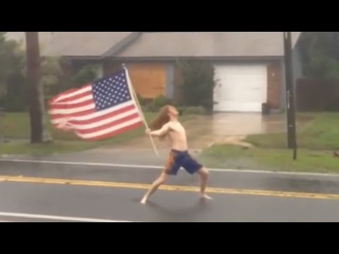 Man Waves American Flag Out While Rocking Out In Hurricane Matthew