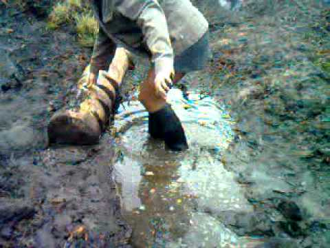 Rubber ridding boots in mud 23gp  YouTube