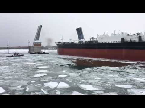 Selvick Marine tugs reposition barge in Sturgeon Bay between downtown bridges