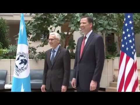 FBI Director James Comey visits INTERPOL