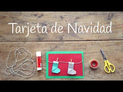 Unas tarjetas de navidad infantiles decoradas con botitas de origami fácil para niños
