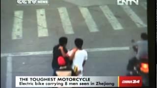 Electric Bike Carrying 8 Men Seen in Zhejiang