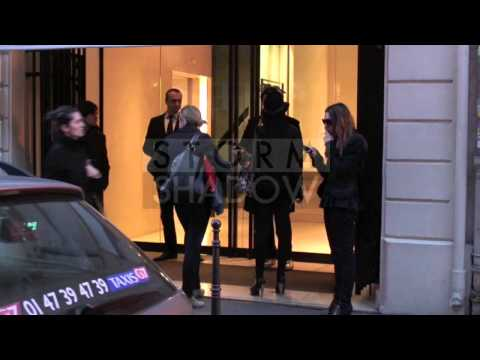 Lindsay Lohan Smokes A Cigarette At Chanel Store In Paris, France.