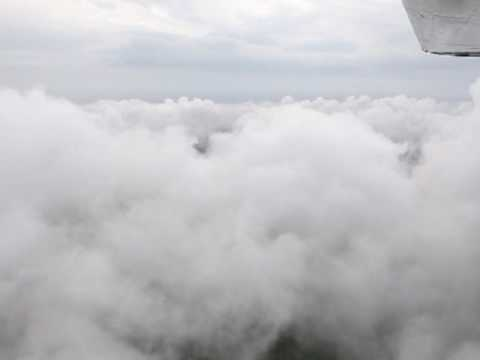 Cessna 177 Cardinal, flying through the clouds above Holland