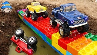 A monster truck crosses a colored block bridge. Color changing vehicles.