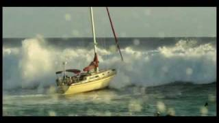 Point Panic! Big Wave hits sailboat at Ala Moana Bowls in Waikiki