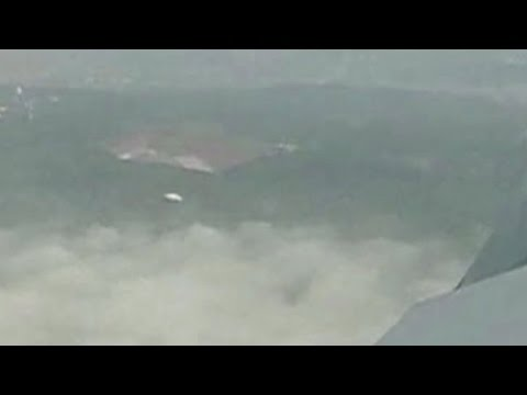 UFO Sighting under Airplane over Canberra, Australia - FindingUFO