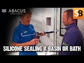 How to Silicone Seal a Shower or Bath - Plumbing Tips