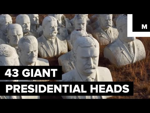 Drone Footage Captures 43 Giant Presidential Heads Sitting Alone in a Field
