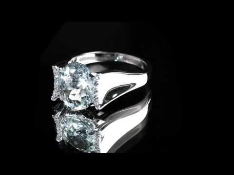 Кольцо из белого золота с аквамарином 5 карат и бриллиантами 0,1 карат