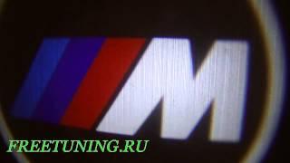 Проекция логотипа на авто БМВ M Freetuning.ru