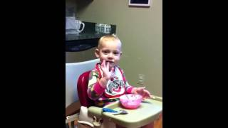 Lizzy Kate eating breakfast- messy and very cute! Thumbnail