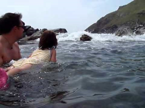 Eliza Grace and Peter Surfing in the Cove Bay