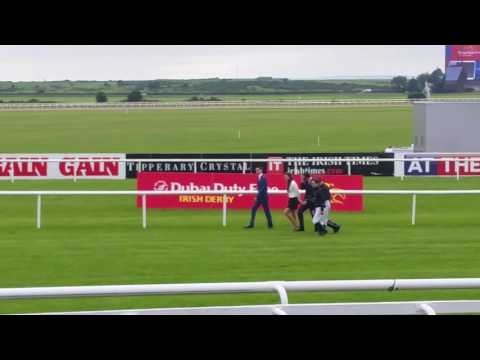 Aidan O'Brien and family walking the course before racing on 2017 Irish Derby day